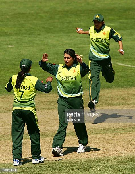 Sana Mir of Pakistan celebrates with Urooj Mumtaz Khan after taking the wicket of Ebony Rainford-Brent of England during the ICC Women's World Cup...
