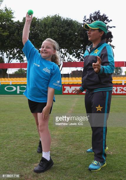Sana Mir of Pakistan in action with local school children during the ICC Cricket for Good clinic at Grace Road on July 13 2017 in Leicester England
