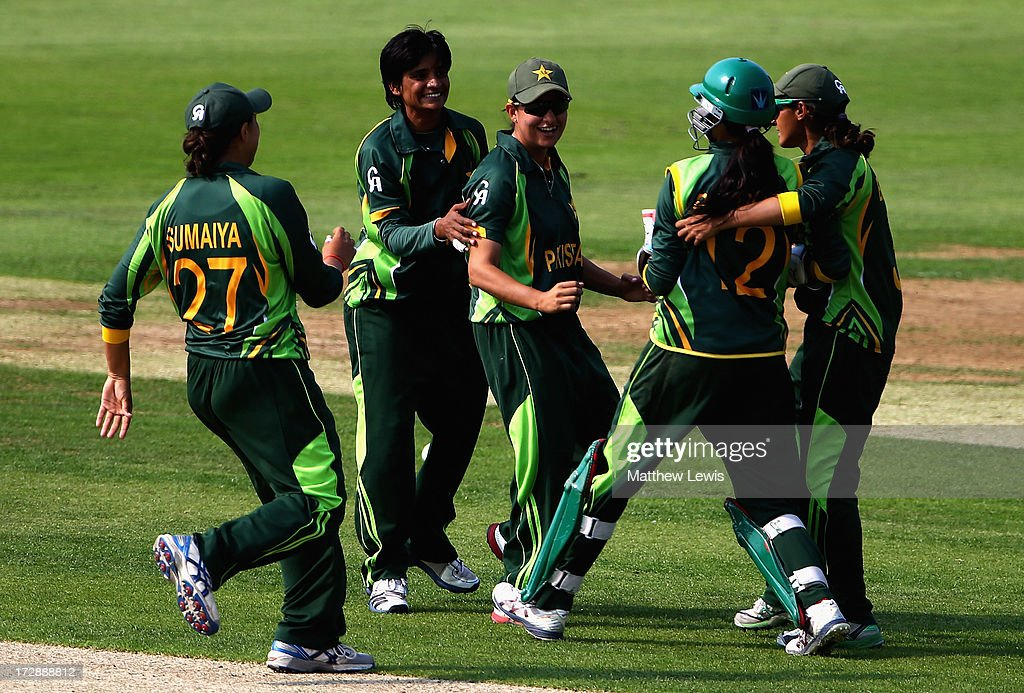 Sana Mir (C) of Pakistan is congratulated by team mates, after catching Amy Jones of England during the 2nd NatWest Women's International T20 match between England Women and Pakistan Women on July 5, 2013 in Loughborough, England.