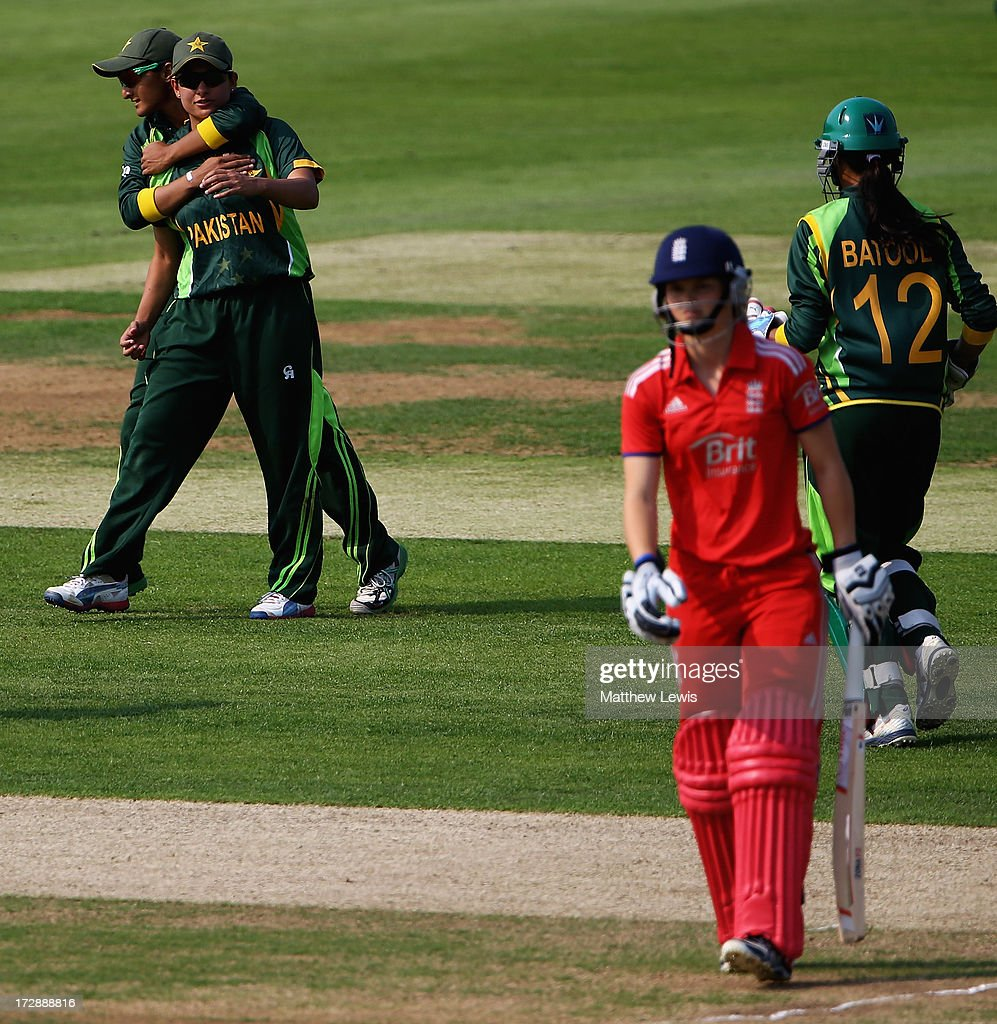 Sana Mir of Pakistan is congratulated by team mates, after catching Amy Jones of England during the 2nd NatWest Women's International T20 match between England Women and Pakistan Women on July 5, 2013 in Loughborough, England.