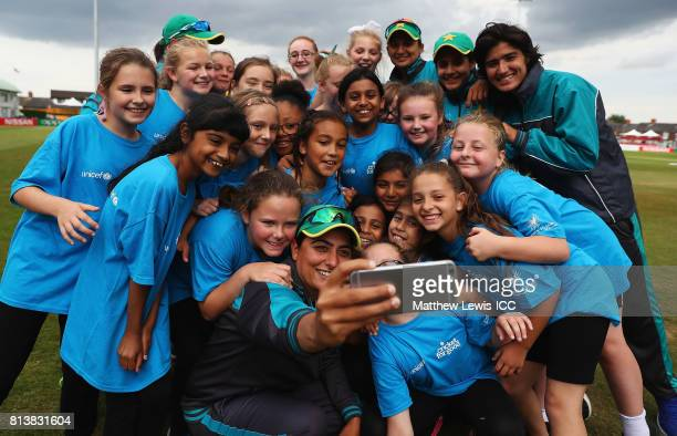 Sana Mir of Pakistan takes a selfie with local school children during the ICC Cricket for Good clinic at Grace Road on July 13 2017 in Leicester...