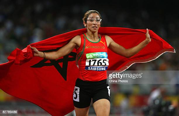 Sanaa Benhama of Morocco celebrates after winning the Women's 400m T13 Final Athletics event at the National Stadium during day six of the 2008...
