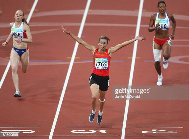 Sanaa Benhama of Morocco celebrates winning gold in the Women's 200m T13 in the Athletics event at the National Stadium during day seven of the 2008...