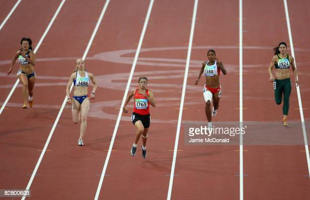 Sanaa Benhama of Morocco runs to win gold in the Women's 200m T13 in the Athletics event at the National Stadium during day seven of the 2008...