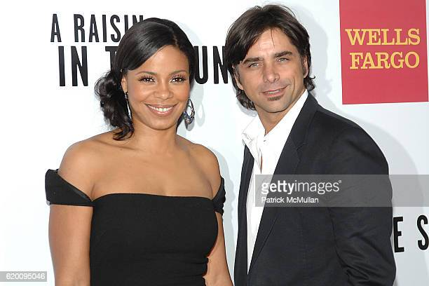 Sanaa Lathan and John Stamos attend West Coast Screening of 'A Raisin in the Sun' at AMC Magic Johnson on February 11 2008 in Los Angeles CA