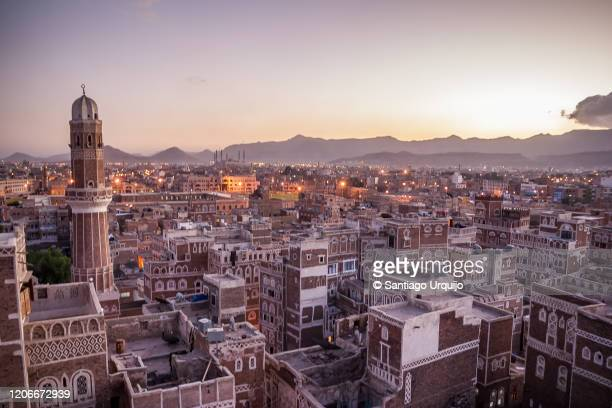 sanaa skyline with traditional mud-brick buildings - sanaa stock pictures, royalty-free photos & images