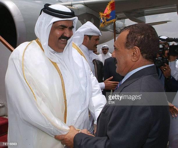Emir of Qatar Sheikh Hamad bin Khalifa al-Thani shakes hands with Yemeni President Ali Abdullah Saleh at Sana'a airport 09 May 2007, after his...