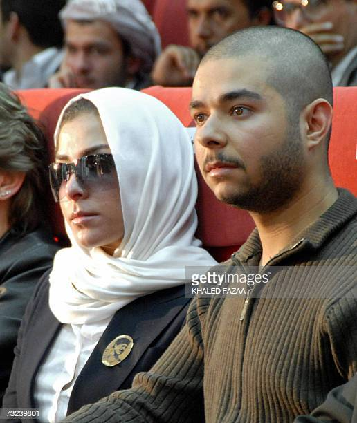 Saddam Hussein's grandson Ali Saddam Kamel attends a memorial service with other unidentified family members held in the Yemeni capital Sanaa on the...