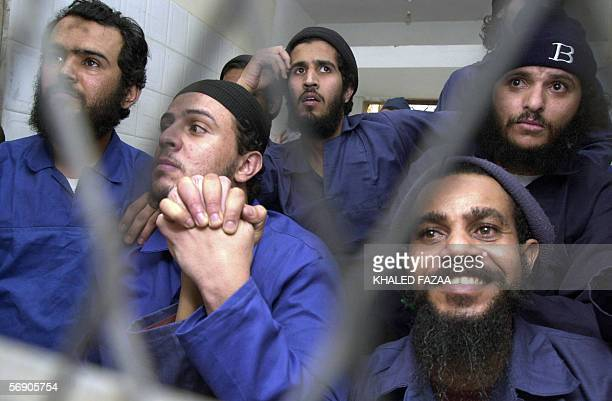 Suspected members of AlQaeda in Yemen are seen behind the bars during the first hearing in their trial at a court in Sanaa 22 February 2006 The 17...