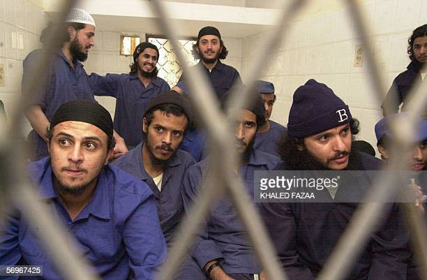 Sana'a YEMEN Suspected members of AlQaeda in Yemen sit behind bars during the second hearing of their trial at a court in Sanaa 01 March 2006 The 17...
