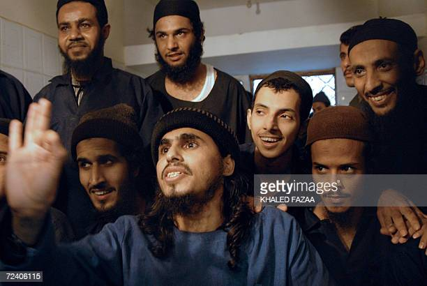 Suspected members of an Al-Qaeda cell in Yemen are seen behind the bars during a hearing at the state security appeal court in Sanaa 04 November...