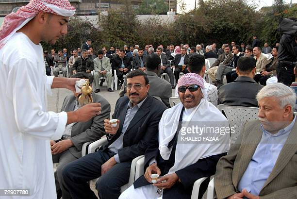 Yemenis drink coffee as unidentified family members of former Iraqi leader Saddam Hussein receive condolences in Sanaa, one day after his execution,...