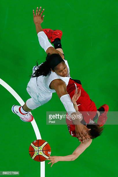 Sanae Motokawa of Japan drives to the basket against Maya Moore of United States on Day 11 of the Rio 2016 Olympic Games at Carioca Arena 1 on August...