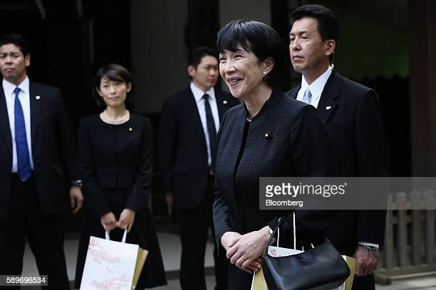 Sanae Takaichi Japan's internal affairs minister front and Tamayo Marukawa Japan's Olympic minister second left visit the Yasukuni Shrine on the...
