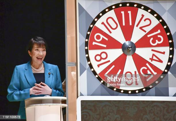 Sanae Takaichi, minister of internal affairs and communications, attends a ceremony for the Year-end Jumbo lottery draw in Tokyo on Dec. 31 with up...