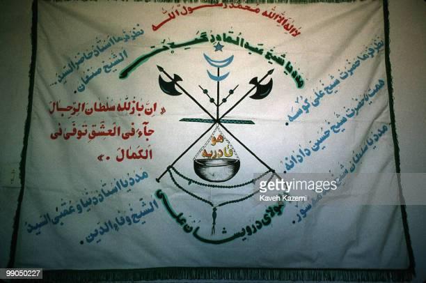 A chart displaying the hierarchy of Kasnazani dervishes hangs on a wall in a Tekieh in Najar village near Sanandaj in Iran's Kurdistan region...