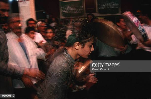 During remembrance ceremony a young dervish whirls while in trance Kasnazani dervishes believe that body piercing with knives skewers drinking poison...