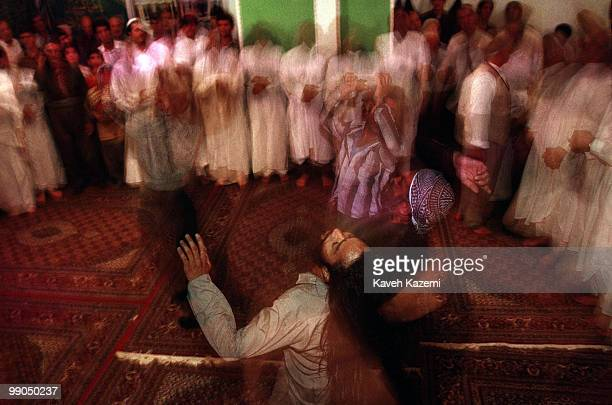 During remembrance ceremony Kasnazani dervishes whirls while in trance sorrounded by a group of dervishes dressed in white and forming a circle...