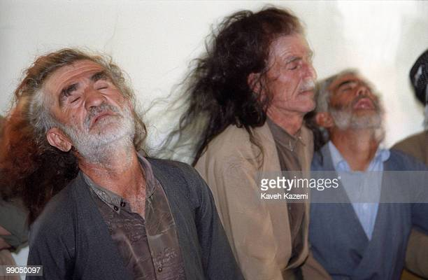 Kasnazani dervishes transcend during a Remembrence ceremony in a Tekieh in Najar village near Sanandaj in Iran's Kurdistan region Kasnazanis are one...