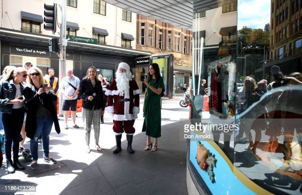 Sanat and Jessica Gomes look on during the 2019 Christmas Window unveiling at David Jones Market Street on November 09 2019 in Sydney Australia