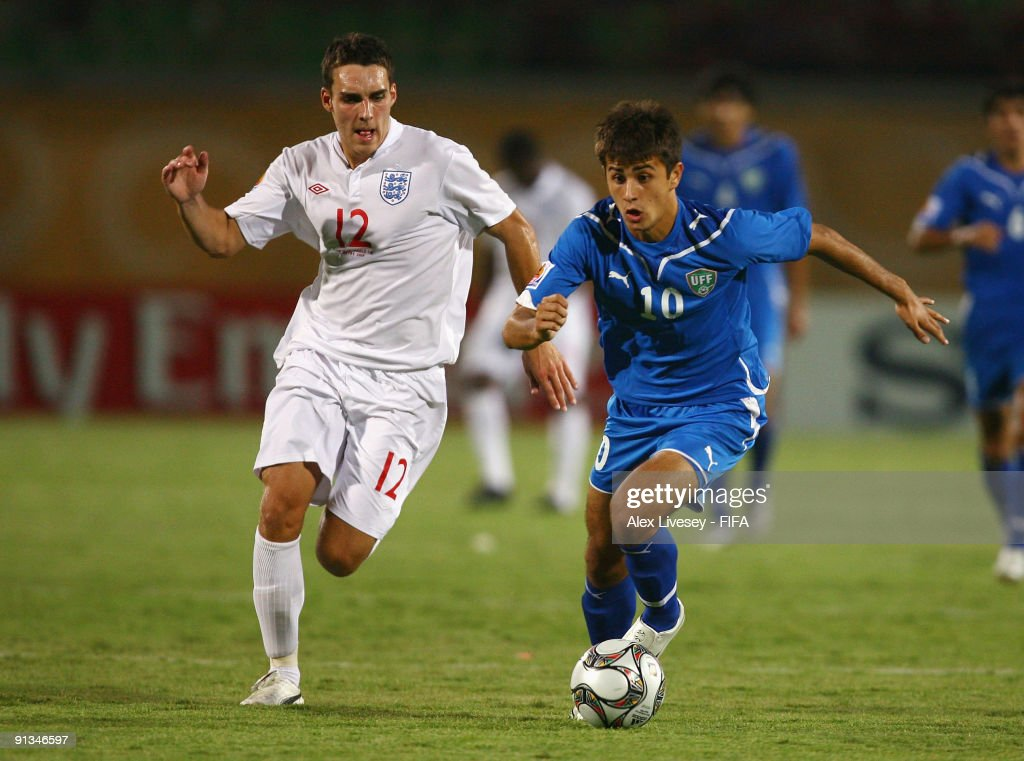 Sanat Shikhov of Uzbekistan beats Matthew James of England during the FIFA U20 World Cup Group D match between Uzbekistan and England at the Mubarak Stadium on October 2, 2009 in Suez, Egypt.