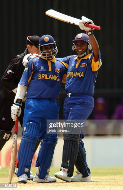 Sanath Jayasuriya and Hashan Tillakaratne of Sri Lanka celebrate sharing a 170run secondwicket stand during the Cricket World Cup Pool B match...