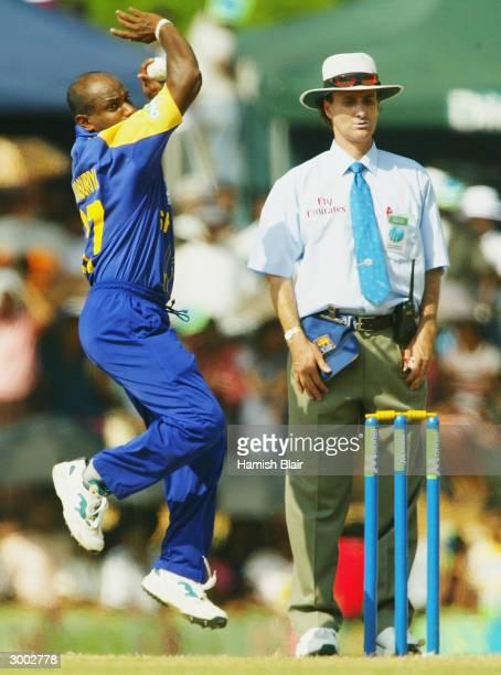 Sanath Jayasuriya of Sri Lanka bowls under the watch of umpire Brent Bowden during the One Day International between Sri Lanka and Australia played...