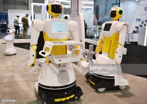 Sanbot Max service robots are seen during CES 2018 at the Las Vegas Convention in Las Vegas on January 12 2018 / AFP PHOTO / MANDEL NGAN