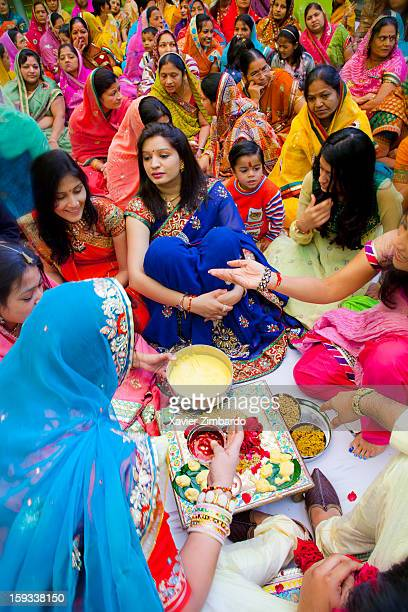Sancheti family ladies performing a 'pooja' with all the guests around during 'paat bithai' function on December 30 2011 at Sancheti House in Pali...