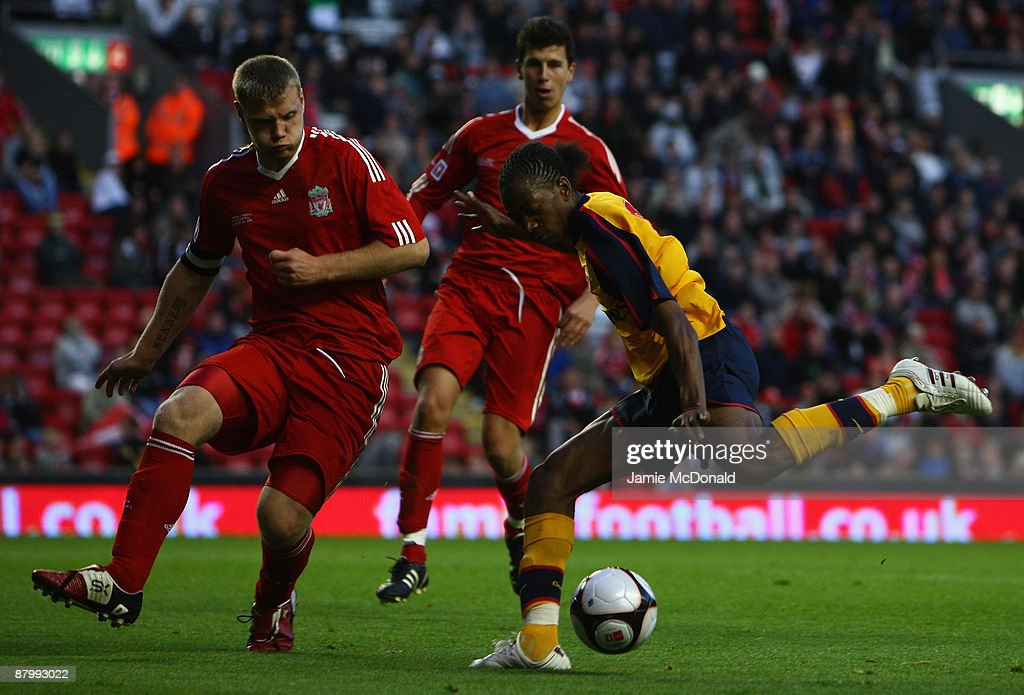 Sanchez Watt of Arsenal shoots past Joe Kennedy of Liverpool to score a goal during the second leg of the FA Youth Cup final sponsored by E.ON, between Liverpool and Arsenal at Anfield on May 26, 2009 in Liverpool, England.