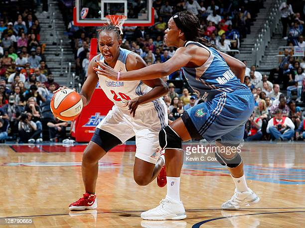 Sancho Lyttle of the Atlanta Dream against Taj McWilliamsFranklin of the Minnesota Lynx in Game Three of the 2011 WNBA Finals at Philips Arena on...