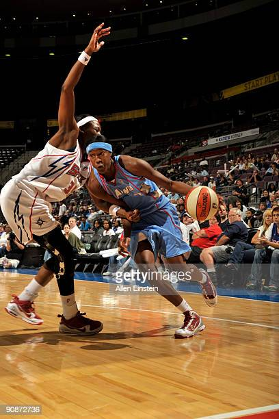 Sancho Lyttle of the Atlanta Dream drives around Cheryl Ford of the Detroit Shock in Game One of the WNBA Eastern Conference SemiFinals on September...