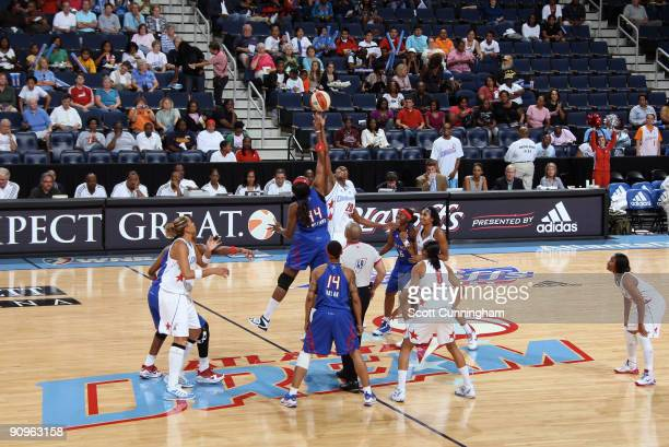 Sancho Lyttle of the Atlanta Dream jumps against Taj McWilliamsFranklin of the Detroit Shock to start Game Two of the WNBA Eastern Conference...