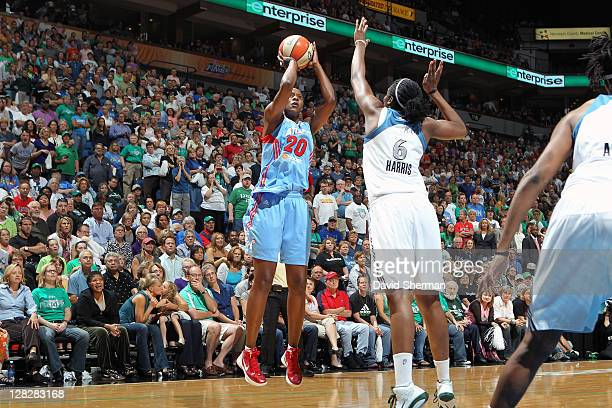 Sancho Lyttle of the Atlanta Dream shoots over Amber Harris of the Minnesota Lynx in Game Two of the 2011 WNBA Finals on October 5 2011 at Target...