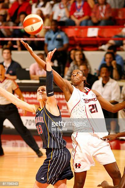 Sancho Lyttle of the Houston Comets shoots the ball over Katie Douglas of the Indiana Fever at Reliant Arena on June 28, 2008 in Houston, Texas. NOTE...