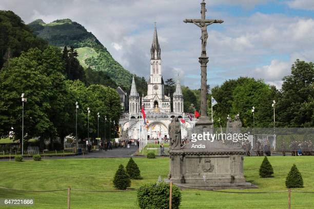 Sanctuary of our Lady of Lourdes Panoramic view of the Basilica of our Lady of the Rosary and the square In the foreground the Breton Calvary May 2015