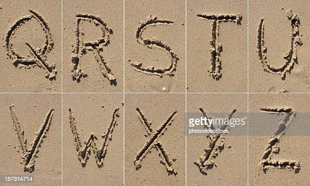 sand alphabet xxxl - letter t stock pictures, royalty-free photos & images