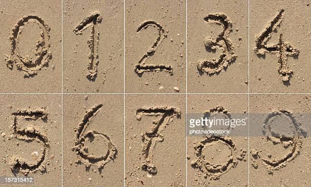sand alphabet xxxl - font stock pictures, royalty-free photos & images