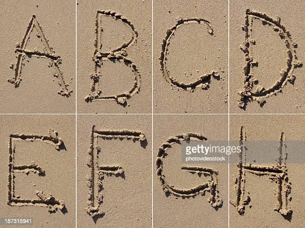 sand alphabet xxxl - nature alphabet letters stock pictures, royalty-free photos & images