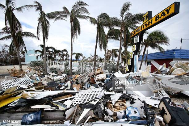 Sand and debris are left on the side of the road following powerful Hurricane Irma on September 12, 2017 in Marathon, Florida in the Florida Keys....