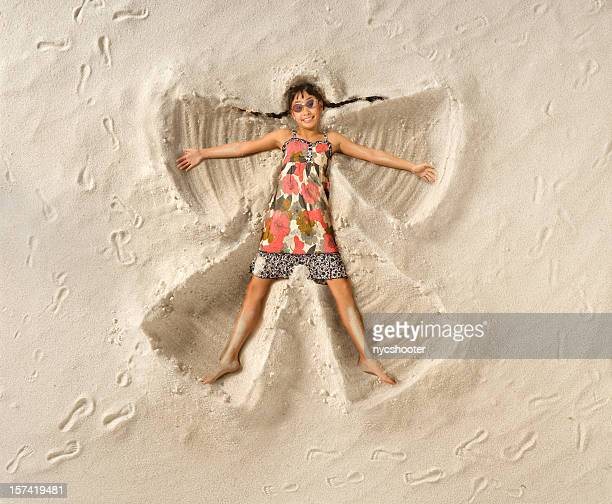 sand angel - snow angel stock photos and pictures