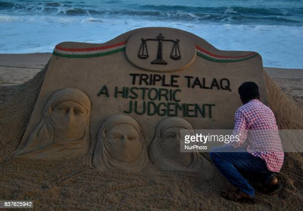 A sand art is seen at the Bay of Bengal Sea's eastern coast beach as it created by Indian sand artist Sudarshan Patnaik for public awareness about...