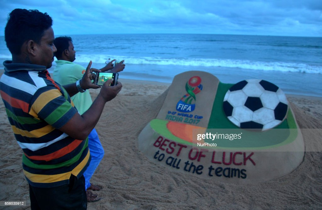 A sand art is seen, creating by Indian sand artist SUdarshan Pattnaik to welcome all players of FIFA U-17 World CUp 2017 matches at the Bay of Bengal Sea's eastern coast beach at Puri, 65 km away from the eastern Indian state Odisha's capital city Bhubaneswar on 7 October 2017.