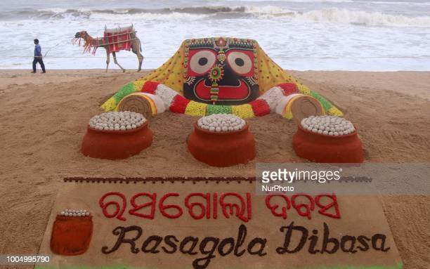 A sand art of Lord Jagannath is seen at the Bay of Bengal Seas eastern coast beach as it is creating by Indian sand artist Sudarshan Pattnaik on the...