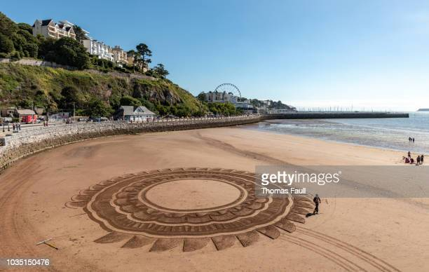 sand art on the beach in torquay, devon - torquay,_victoria stock pictures, royalty-free photos & images