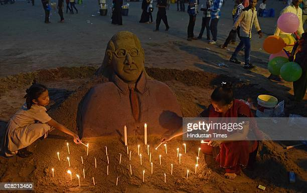 Sand artist Laxmi Gaud making a sand art of Babasaheb Ambedkar on the eve of death anniversary of Dr Babasaheb Bhim Rao Ambedkar at Juhu beach on...