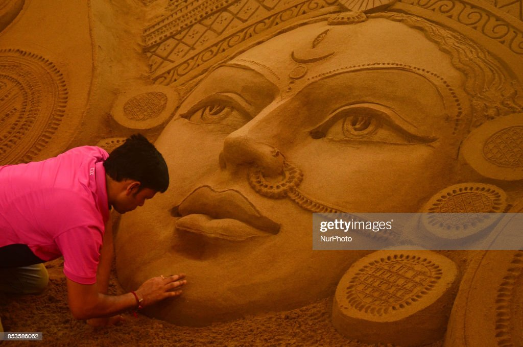 Sand artist gives a finishing touch to Durga Sand Idol : News Photo