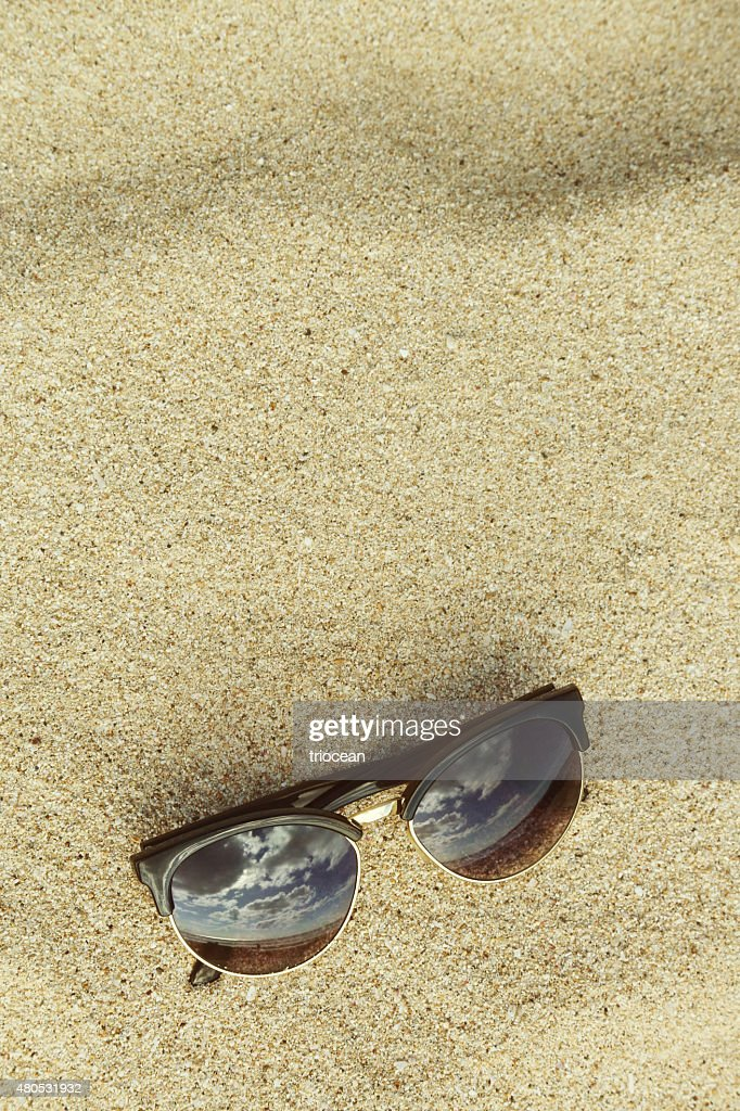 Sand background with sunglasses at the beach : Bildbanksbilder