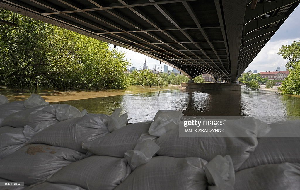 Sand badgs under a bridge protect the road street from high water at Wisla river on May 21, 2010.Flash floods caused by days of heavy rainfall have hit parts of central Europe, killing at least seven people, disrupting power supplies and forcing thousands of people from their homes. Southern Poland, parts of the Czech Republic and Slovakia and northern Hungary are among the worst affected regions