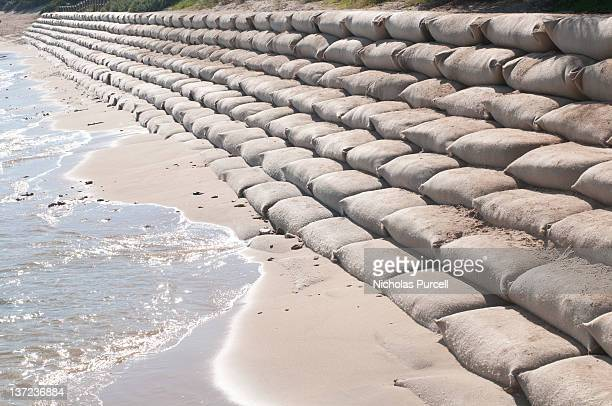 sand bags on beach - sandbag stock pictures, royalty-free photos & images